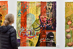 "© Licensed to London News Pictures. 06/10/2017. London, UK.  A woman views ""Misunderstood Princess I"", 2017, by J Roldan at The Other Art Fair, presented by Saatchi Art, taking place at the Old Truman Brewery in East London from 5 to 8 October 2017.  The fair brings 130 artists, hand selected by a panel of experts, to present their works for sale directly to the public. Photo credit : Stephen Chung/LNP"