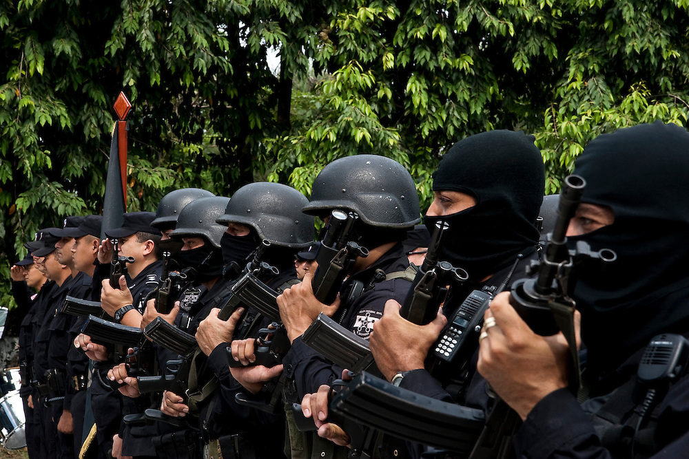 An elite PNC anti-gang squad salutes at a ceremony in which they received new riot gear in San Salvador.  The police is struggling to better train its officers, stamp out corruption and build confidence with a disillusioned public.