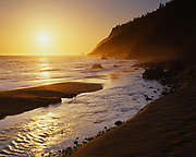 Usal Creek entering the Pacific Ocean at sunset, Lost Coast, Sinkyone Wilderness State Park, California.