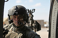 1-244 Air Helicopter Battalion ( part of the 34th Air Brigade) is made up of companies from the Louisiana and Florida National guards. They conduct air assault and air movement operation including acting as a taxi service around  Baghdad flying a ring around the bases before returning to their hub in Balad.  It cost $6000 an hour to operate a blackhawk, so it isn't the most cost effective way to get around but it is the safest. ///SSG Warren Ezell, a gunner on a blackhawk gets out of the helicopter to help passengers in  BIOP