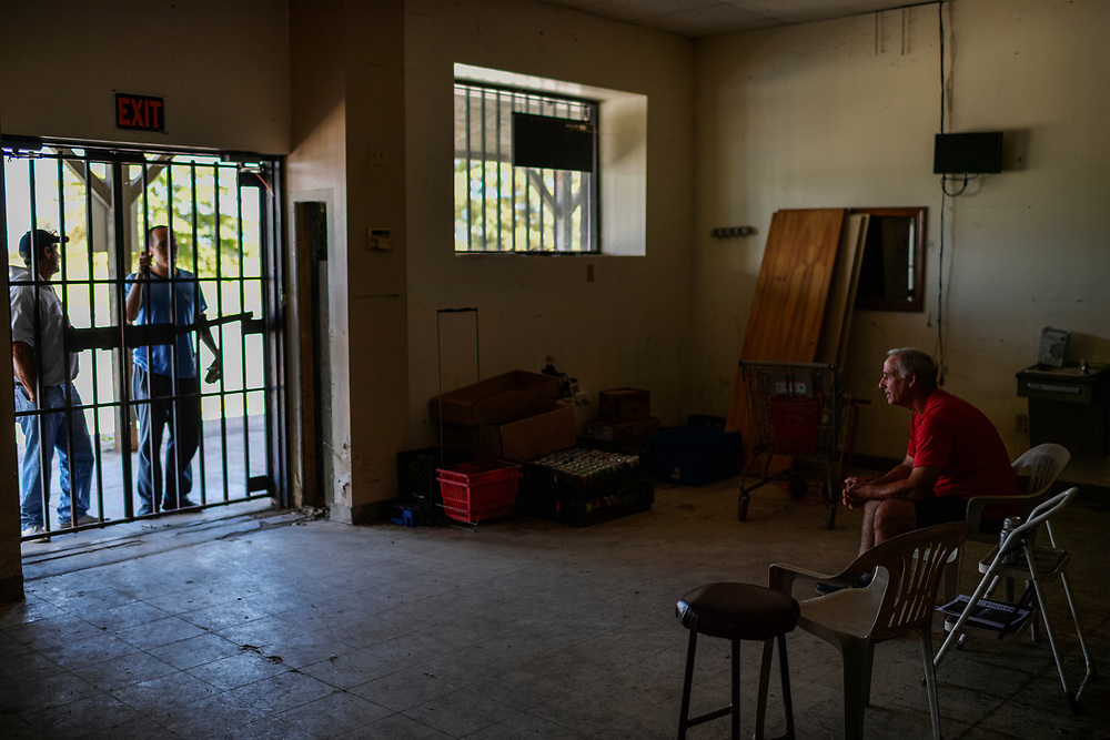 """Men chat with Snoddy through the store's barred entrance on Wednesday, September 25, 2019. The pair were passing through from Columbia. """"I just wanted to show him a true piece of Americana,"""" the older man said. Snoddy's Store has been in operation since 1924 and is well known throughout the region as a place to grab supplies and have a good lunch. Howard County failed to be designated as a disaster area by the federal government. FEMA funds that could be used to resuscitate the store are not forthcoming. As a result, Jim and Chris Snoddy are preparing for the possibility of closing the store permanently."""