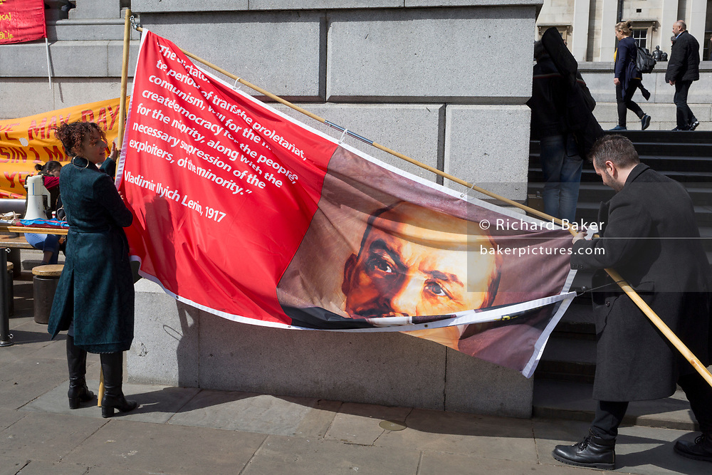 Members of the Communist Party of Great Britain gather with the face Soviet leader Lenin on a banner in Trafalgar Square during the traditional May Day celebrations in the capital, on 1st May 2018, in London, England.