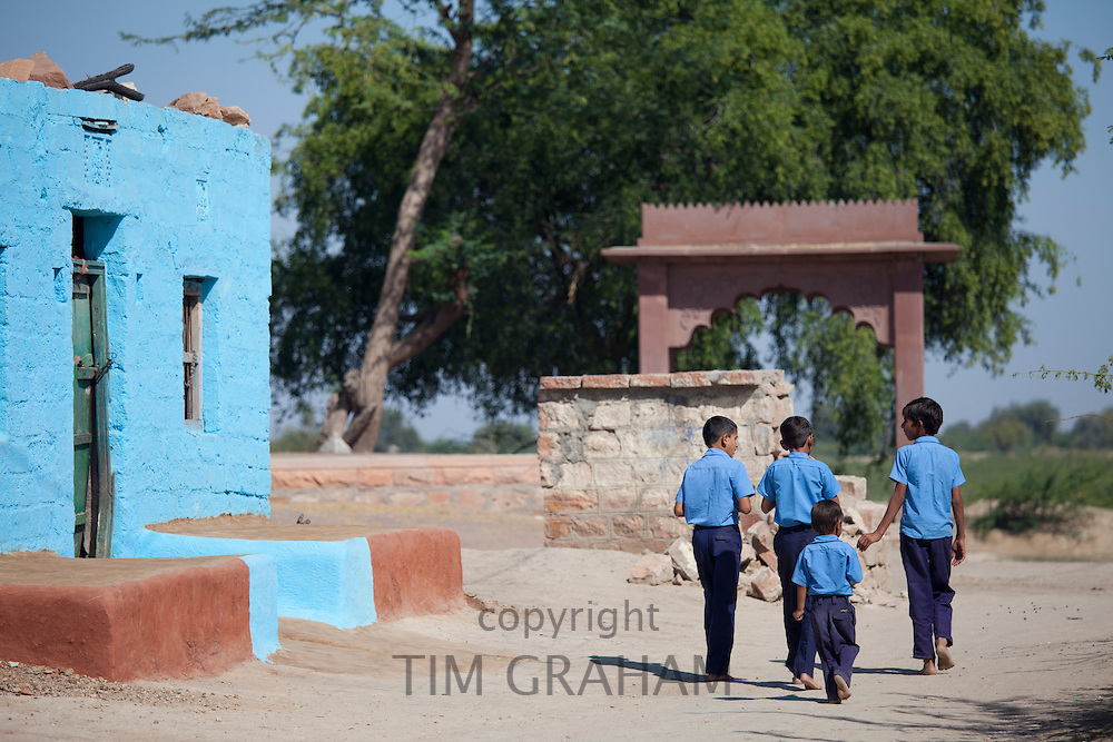 Boys in Hindu Brahman high caste village of Dhudaly heading for school in Rajasthan, Northern India
