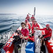 © Maria Muina I MAPFRE: Shore crew on the rib team following the boat. Equipo de tierra en la neumática del equipo siguiendo el barco.