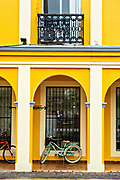 Brightly painted colonnaded style buildings along the Venustiano Carranza pedestrian walkway in Tlacotalpan, Veracruz, Mexico. The tiny town is painted a riot of colors and features well preserved colonial Caribbean architectural style dating from the mid-16th-century.