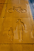 A detail view of a stencil depicting a bike and pedstrians on a shared multicoloured pedestrianised traffic-free thoroughfare in the City of London, capitals financial district, aka The Square Mile, on 20th October 2021, in London, England.
