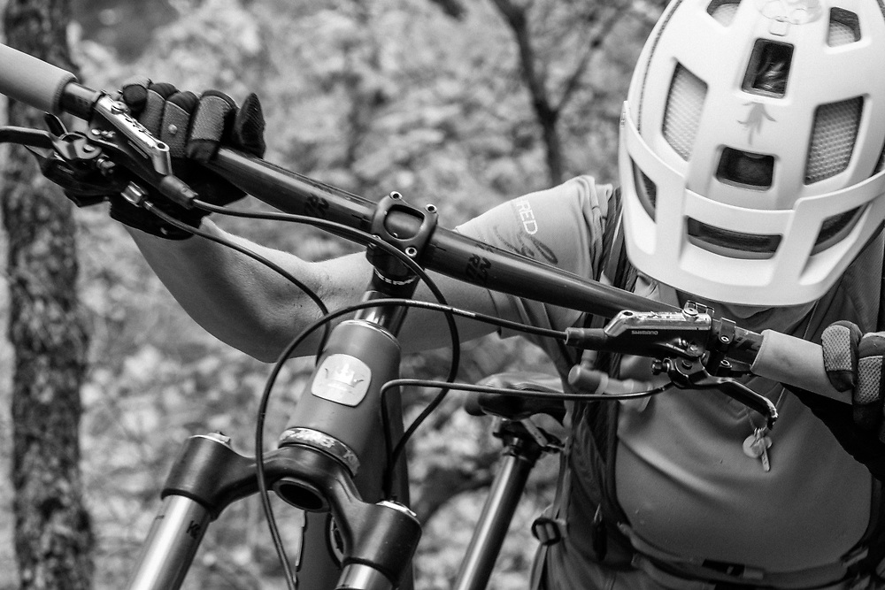 Heather Goodrich hiking her bike up an unnamed single track in Alpine, Wyoming.