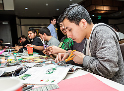 IRVINE, CA - MARCH 2: Students create collages from magazines clips at the Treasure Room during the Working Wardrobes Dream Girls & Distinguished Gentlemen 2013 event at the Irvine Hilton in Irvine, CA. Working Wardrobes (http://www.workingwardrobes.org) is a non-profit organization located in Costa Mesa, CA. PHOTO: © 2013 SILVEX.PHOTOSHELTER.COM.