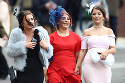 Female racegoers during Ladies Day of the 2018 Cheltenham Festival at Cheltenham Racecourse.