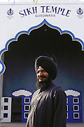 Sikh farmer in Yuba City, California, in front of the Sikh Temple. MODEL RELEASED.