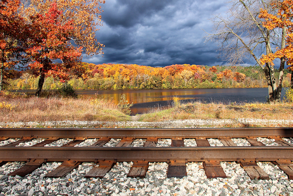 """""""Fall Storm Tracking""""<br /> <br /> A beautiful and unique perspective on an autumn storm, railroad tracks, and gorgeous fall color!<br /> <br /> Autumn Landscapes by Rachel Cohen"""