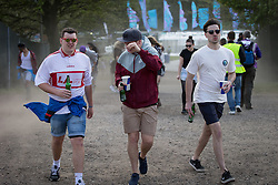 © Licensed to London News Pictures .06/06/2015. Manchester , UK.  Gusts of wind stir up dust and grit and force festival goers to hold on to their hats . Early arrivals at The Parklife 2015 music festival in Heaton Park , Manchester . Photo credit : Joel Goodman/LNP