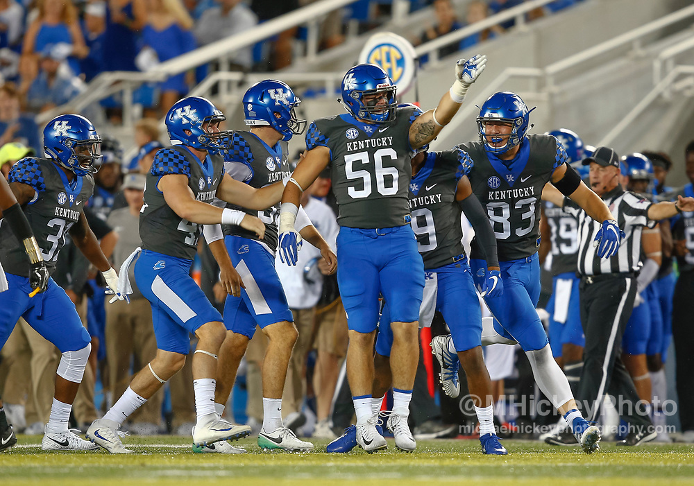 LEXINGTON, KY - OCTOBER 07: Members of the Kentucky Wildcats defense celebrate a turnover during the game against the Missouri Tigers at Commonwealth Stadium on October 7, 2017 in Lexington, Kentucky. (Photo by Michael Hickey/Getty Images)