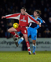 Photo. Richard Lane.<br />Wycombe Wanderers v Leyton Orient. Coca Cola League Two. 29/12/2005.<br />Wycombe's Clint Easton  challenges Craig Easton.