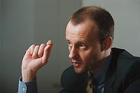 18 JAN 2001, BERLIN/GERMANY:<br /> Friedrich Merz, CDU, CDU/CSU Fraktionsvorsitzender, waehrend einem Interview, in seinem Buero, Deutscher Bundestag, Reichstagsgebaeude<br /> IMAGE: 20010118-01/01-08
