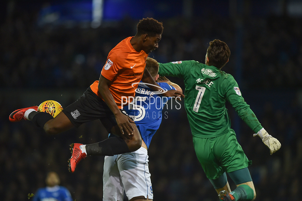 Southend United Midfielder, Jermaine McGlashan (17) challenges Portsmouth Defender, Matt Clarke (5) and Portsmouth Goalkeeper, Luke McGee (1) during the EFL Sky Bet League 1 match between Portsmouth and Southend United at Fratton Park, Portsmouth, England on 18 November 2017. Photo by Adam Rivers.