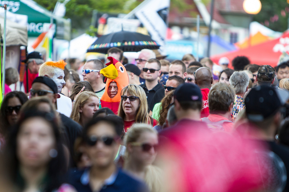 Russell Holmes (rooster) and Thawn Schalesky (egg) of Sioux Falls, SD, walk through the crowd at the Twin Cities Pride Festival in Loring Park in Minneapolis June 28, 2015.