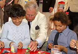 Britain's Prince Charles (C) plays with Syrian refugee kids upon his visit to King Abdullah Park for Syrian Refugees at Ramtha city, north of Amman, on March, 13 2013. Prince Charles and his wife Camilla visited a camp for Syrian refugees in northern Jordan as part of a trip to the Middle East, an official said, March 13, 2013. Photo by Imago / i-Images...UK ONLY..