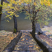 Stone steps which lead to the Applegate River near the McKee Covered Bridge in southern Oregon.  The Applegate River is a 51-mile (82 km) long tributary of the Rogue River. It drains forested foothills of the Siskiyou Mountains along the Oregon-California border.