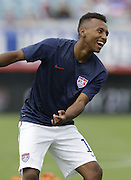 JACKSONVILLE, FL - JUNE 07:  Defender Julian Green #16 of the United States warms up before the international friendly match against Nigeria at EverBank Field on June 7, 2014 in Jacksonville, Florida.  (Photo by Mike Zarrilli/Getty Images)