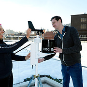 The Weather Company Meteorologist, Jess Parker (left) works with IBM Watson Developer Chris Ackerson (right) to install a personal weather station on the roof of IBM Watson Headquarters at Astor Place in New York City. More than 180,000 people around the world connect personal weather stations, like the one pictured, to Weather Underground's worldwide personal weather station network to share live, localized weather data to people around the globe. IBM today announced that it has closed the acquisition of The Weather Company's B2B, mobile and cloud-based web-properties,weather.com, Weather Underground, The Weather Company brand and WSI, its global business-to-business brand. (Jon Simon/Feature Photo Service for IBM)