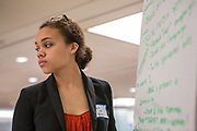 Purchase, NY – 31 October 2014. Naira Luke-Aleman of Yonkers Montessori writing presentation notes for her team. The Business Skills Olympics was founded by the African American Men of Westchester, is sponsored and facilitated by Morgan Stanley, and is open to high school teams in Westchester County.