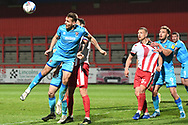 Cheltenham Town Defender Chris Hussey(3) heads the ball during the EFL Sky Bet League 2 match between Stevenage and Cheltenham Town at the Lamex Stadium, Stevenage, England on 20 April 2021.