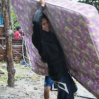 A man salvages furniture from his home as the Río Blanco in San Pedro Sula rose and swelled with fast-running water as hurricane Iota pushed into Honduras. Precarious housing on the riverside began to be washed away and people rushed to save their belongings.