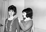 London girls competing in Irish Dancing Championships, Dublin. Angela Lincoln (who has no irish connection) helps Maureen McDonnell (whose parents hail from Waterford) to prepare for her appearance in the Irish Senior Girls Championship..21.02.1965