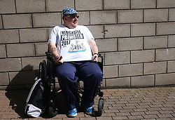 13 August 2017  : Premier League Football : Newcastle United v Tottenham Hotspur:  a Newcastle fan proudly shows off his promotion T-Shirt: Photo: Mark Leech