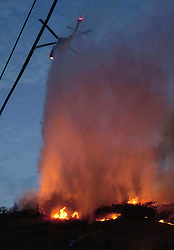September 2, 2017 - Burbank, CA, USA - A helicopter makes a water drop on the hillside at the end of Petaluma Dr. as the fire comes dangerously close to homes in Sun Valley on Saturday, September 2, 2017. (Credit Image: © Paul Rodriguez/The Orange County Register via ZUMA Wire)