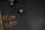 Sandals sit by the wrestling mats at Jackson Wink MMA in Albuquerque, New Mexico on June 9, 2016.