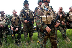 July 14, 2005. Shelby, Mississippi..Preparing troops for war - 'Reality' training at Camp Shelby, Mississippi.  National Guardsmen from the 2/127th Bravo Company, Wisconsin National Guard train for likely Iraq scenarios before deployment. Debrief following mock roadside bombing..Photo; Charlie Varley