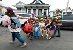 15 Feb 2015. New Orleans, Louisiana.<br /> Mardi Gras. Ben and the Ribkas get a ride back from The Krewe of Thoth.<br /> Photo; Charlie Varley/varleypix.com