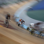 A blur of motion as cyclists compete during the 2012 Oceania WHK Track Cycling Championships, Invercargill, New Zealand. 21st November 2011. Photo Tim Clayton...