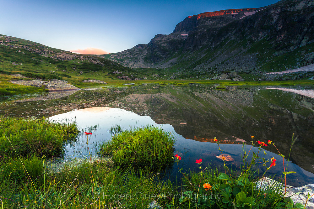 Reflections in a mountain lake at summer time