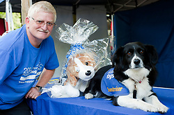 Tony Atkin and Missy of the Support Dogs charity which provides assistance dogs for the disabled and people who suffer from epilepsy and children with autism at Rotherham Show in Clifton Park on Saturday<br /> <br /> 8 September 2012<br /> Image © Paul David Drabble