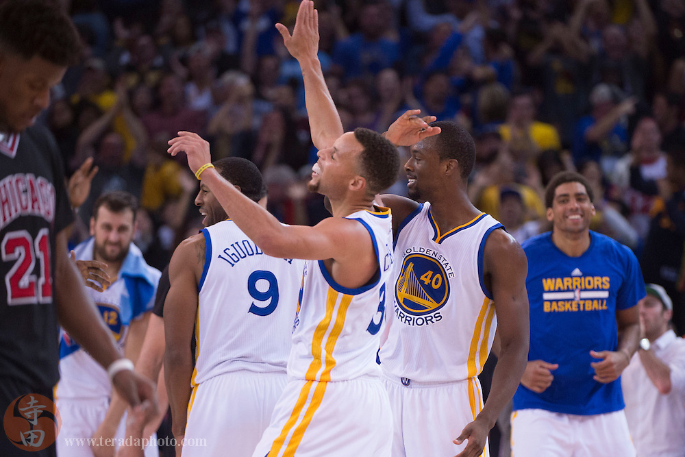 November 20, 2015; Oakland, CA, USA; Golden State Warriors forward Harrison Barnes (40) celebrates with guard Stephen Curry (30) during the fourth quarter against the Chicago Bulls at Oracle Arena. The Warriors defeated the Bulls 106-94.