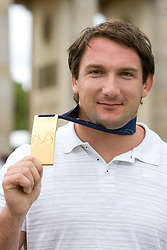 Olympic and World Champion Primoz Kozmus of Slovenia poses at Brandenburger Tor with his gold medal medal after he won the men's Hammer Throw Final at the 12th IAAF World Athletics Championships at the Olympic Stadium, on August 18, 2009 in Berlin, Germany. (Photo by Vid Ponikvar / Sportida)