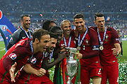Portugal players celebrate with the trophy during the Euro 2016 final between Portugal and France at Stade de France, Saint-Denis, Paris, France on 10 July 2016. Photo by Phil Duncan.