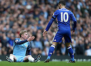 Kevin De Bruyne of Manchester City is helped up by Eden Hazard of Chelsea during the Premier League match at the Etihad Stadium, Manchester. Picture date: December 3rd, 2016. Pic Simon Bellis/Sportimage