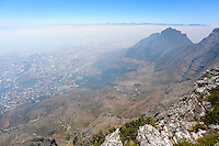 Table Mountain is a flat mesa  overlooking the city of Cape Town in South Africa. Devil's Peak to the east.