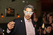 New York, NY - October 27, 2014: A guest wearing Asahi branded sunglasses at the International Chefs Congress afterparty, hosted by StarChefs. <br /> <br /> CREDIT: Clay Williams for StarChefs.<br /> <br /> © Clay Williams / claywilliamsphoto.com