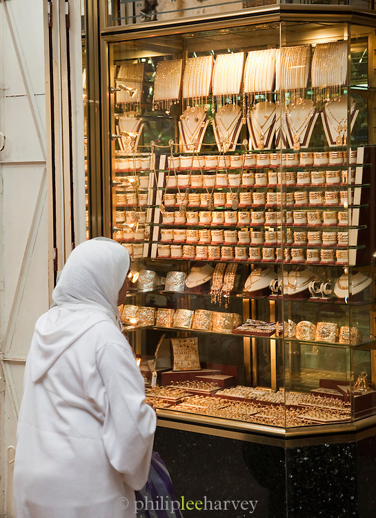 A woman shopping for gold and jewellery in the medina of Fes, Morocco