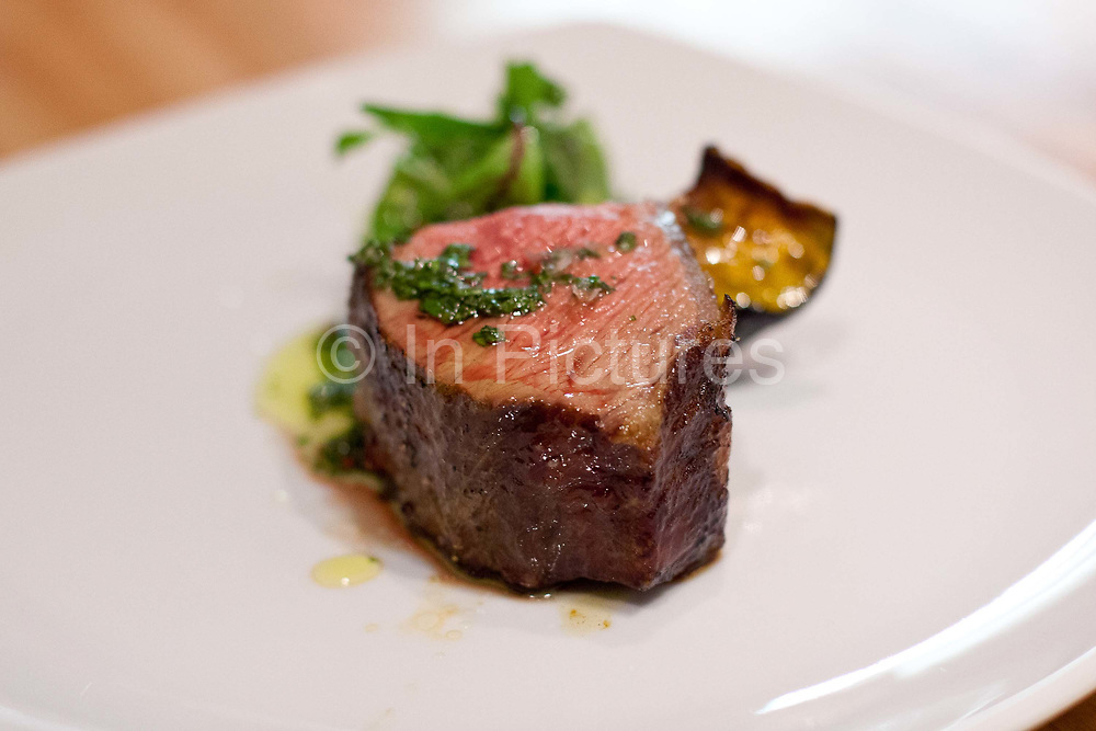 A steak / bife de chorizo at One table at HG restaurant, Palermo, Buenos AIres, Argentina. .