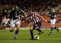 Photo. Jed Wee.<br /> Sunderland v Plymouth Argyle, Coca Cola Championship, 15/03/2005.<br /> Sunderland's Marcus Stewart (R) twists and turns Plymouth's Graham Coughlan into conceding a penalty.