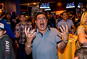 Long-time Los Angeles Chargers season ticket holder Edward Nguyen of Diamond Bar reacts as the Chargers pick wide receiver Mike Williams in the first round of the 2017 NFL draft. Nguyen, who wasn't happy with the team's pick, was at the Chargers draft party at the ESPN Zone in Anaheim, CA.