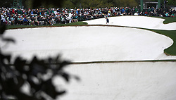 April 6, 2017 - Augusta, GA, USA - Matthew Fitzpatrick, top right/center, walks out of a sand trap along the 18th green with his head down following a shot during first round action of the 2017 Masters Tournament at Augusta National Golf Club on Thursday, April 6, 2017 in Augusta, Ga. McGirt finished the round at -3. (Credit Image: © Jeff Siner/TNS via ZUMA Wire)