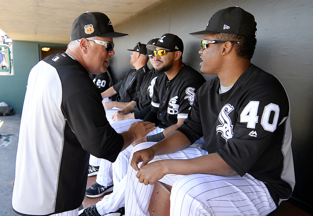GLENDALE, ARIZONA - MARCH 06:  Manager Rick Renteria #17 of the Chicago White Sox interacts with Reynaldo Lopez #40 prior to the spring training game against the San Diego Padres on March 6, 2017 at Camelback Ranch in Glendale Arizona.  (Photo by Ron Vesely)   Subject:  Reynaldo Lopez; Rick Renteria