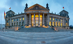 Exterior view of Reichstag German parliament building at dusk in Berlin, Germany